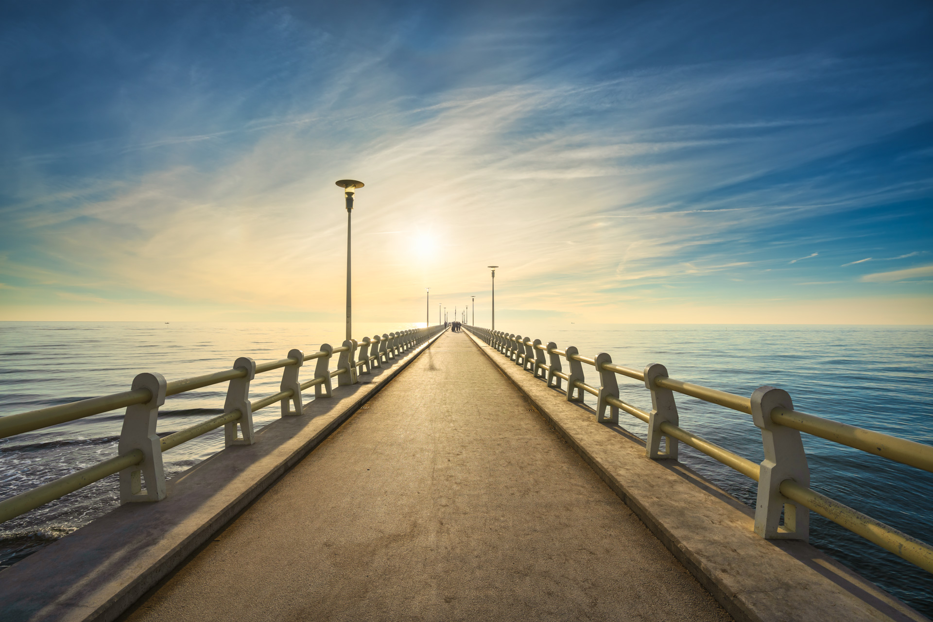 Pier or jetty, footpath promenade and sea in Forte dei Marmi at sunset. Versilia Lucca Tuscany Italy